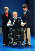 New York, NY - August 31, 2004 -- Sergeant Steven McDonald of New York, New York, center, a New York City police officer wounded in the line of duty, at the 2004 Republican Convention in Madison Square Garden in New York on Tuesday, August 31, 2004.  Sergeant McDonald was shot by a teen-age assailant in Central Park, New York in July, 1986.  With him are his wife, Patty Ann, left, and son, Connor, right..Credit: Ron Sachs / CNP.(RESTRICTION: No New York Metro or other Newspapers within a 75 mile radius of New York City)