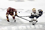 ST PAUL, MN - APRIL 7: Andrew Peeke #22 of the Notre Dame Fighting Irish and Karson Kuhlman #20 of the Minnesota-Duluth Bulldogs battle for the puck during the Division I Men's Ice Hockey Semifinals held at the Xcel Energy Center on April 7, 2018 in St Paul, Minnesota. (Photo by Carlos Gonzalez/NCAA Photos via Getty Images)