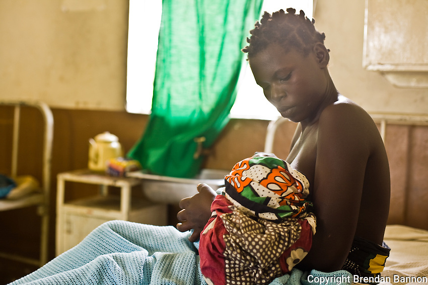 """Milka Anyango Odondi  wants to be a grandmother someday. Today she gave birth this morning to a healthy baby boy. They are both HIV negative...   """"When I was pregnant I wanted to know  my status- I wanted to take every precaution              to protect the life of my child. This is my third child and  we are all Negative..I have been taking care of myself well. I don't move around with other men and I believe my husband is the same. We stick to each other...My husband tests every three months and is not going around with other women. We sat together and spoke about our lives and  pledged to concentrate our love in our family...I encourage  my friends to take care good care and to not move around with other men..If they stay  healthy they can take care of their children for a long time. If they move around they  might die and  leave their children  at too young of an age...I want to be a grandmother; I am dreaming of it. I want the pleasure of  seeing my children grow and I  figure that  by old age I'll have a lot to teach the younger ones...I have known some wise women and I want  to be among them someday.  I have seen their homes grow well through their wisdom. I wish to be the same.""""..Hours after the birth, Milka hadn't chosen a name for the boy. She hadn't talked to her husband yet. He works on a tea plantation in another district. In the rush to the hospital she  forgot to bring his phone number. When she speaks to him she will ask if he likes the name Ian Anyango.."""