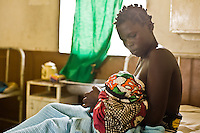"Milka Anyango Odondi  wants to be a grandmother someday. Today she gave birth this morning to a healthy baby boy. They are both HIV negative...   ""When I was pregnant I wanted to know  my status- I wanted to take every precaution              to protect the life of my child. This is my third child and  we are all Negative..I have been taking care of myself well. I don't move around with other men and I believe my husband is the same. We stick to each other...My husband tests every three months and is not going around with other women. We sat together and spoke about our lives and  pledged to concentrate our love in our family...I encourage  my friends to take care good care and to not move around with other men..If they stay  healthy they can take care of their children for a long time. If they move around they  might die and  leave their children  at too young of an age...I want to be a grandmother; I am dreaming of it. I want the pleasure of  seeing my children grow and I  figure that  by old age I'll have a lot to teach the younger ones...I have known some wise women and I want  to be among them someday.  I have seen their homes grow well through their wisdom. I wish to be the same.""..Hours after the birth, Milka hadn't chosen a name for the boy. She hadn't talked to her husband yet. He works on a tea plantation in another district. In the rush to the hospital she  forgot to bring his phone number. When she speaks to him she will ask if he likes the name Ian Anyango.."