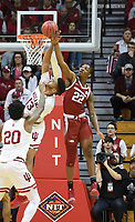 NWA Democrat-Gazette/CHARLIE KAIJO Arkansas Razorbacks forward Gabe Osabuohien (22) blocks Indiana Hoosiers forward Juwan Morgan (13) during the second half of the NCAA National Invitation Tournament, Saturday, March 23, 2019 at the Simon Skjodt Assembly Hall at the University of Indiana in Bloomington, Ind. The Arkansas Razorbacks fell to the Indiana Hoosiers 63-60.