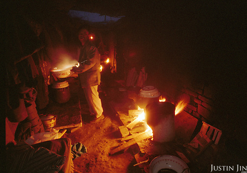 A Sichuanese man cooks at garbage dump in Beijing..Picture taken March 1999.Copyright Justin Jin