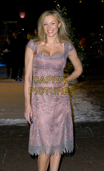 """NELL McANDREW .At the UK Film Premiere of """"The Holiday"""", Odeon Leicester Square, London, UK..December 5th 2006.half length purple silver lace dress hand on hip.CAP/CAN.©Can Nguyen/Capital Pictures"""