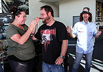 "Whitney Harris (L) and Daniel McNicholl react as Greg Murphy hands over the keys to a new 2017 Barina. Holden New Zealand, ""Mullet Amnesty Day"", trade your mullet for a Holden Astra, West City Holden, Auckland, New Zealand, Saturday 1st April 2017. Photo: Simon Watts/www.bwmedia.co.nz"