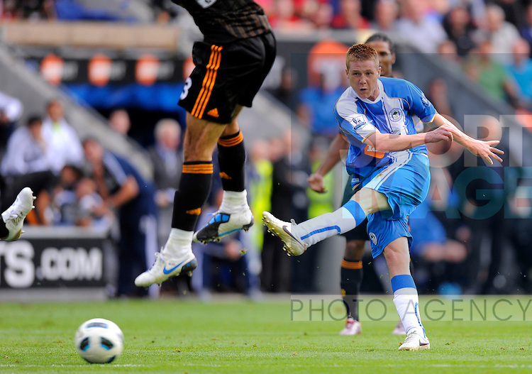 James McCarthy of Wigan Athletic takes a shot on goal