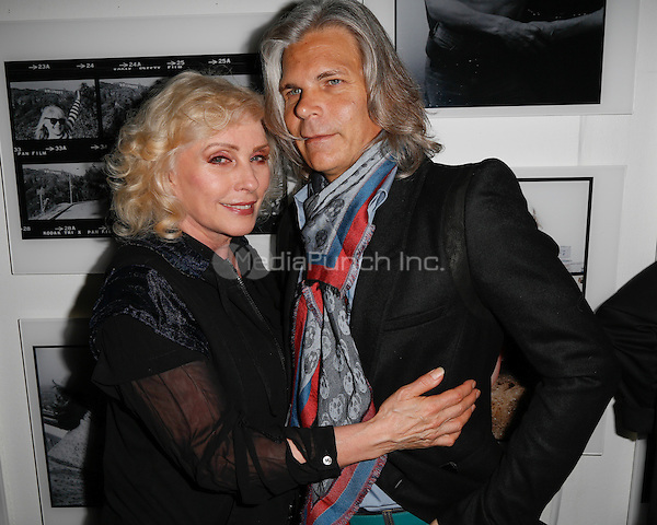 New York, NY - September 22 : Debbie Harry and Guest attend Blondie's 40th Anniversary Exhibition Hosted by Jeffrey Deitch held at the Chelsea Hotel Storefront Gallery on September 22, 2014 in New York City. (Photo by Brent N. Clarke / MediaPunch)