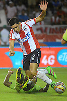 BARRANQUILLA- COLOMBIA -21-05-2016: Roberto Ovelar, jugador de Atletico Junior en acción, durante partido entre Atletico Junior y Cortulua, de la fecha 19 de la Liga Aguila I-2016, jugado en el estadio Metropolitano Roberto Melendez de la ciudad de Barranquilla. / Roberto Ovelar, player of Atletico Junior in action, during a match between Atletico Junior and Cortulua, for date 19 of the Liga Aguila I-2016 at the Metropolitano Roberto Melendez Stadium in Barranquilla city, Photo: VizzorImage  / Alfonso Cervantes / Cont.