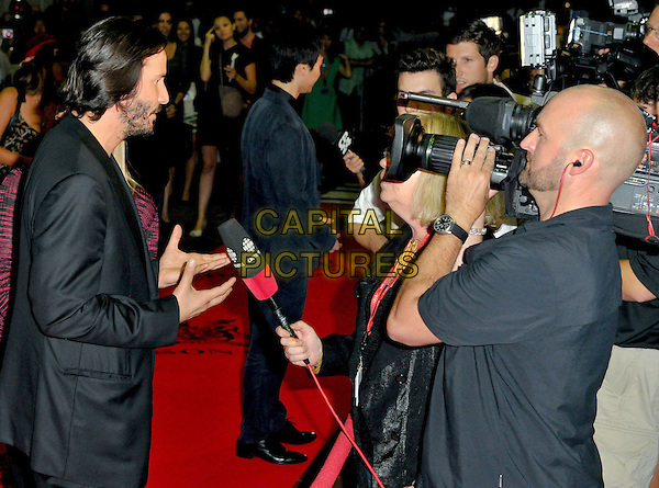 Keanu Reeves<br /> &quot;Man Of Tai Chi&quot; Premiere - 2013 Toronto International Film Festival held at Ryerson Theatre, Toronto, Ontario, Canada.<br /> September 10th, 2013<br /> half length black suit jacket top beard facial hair side profile hands arms interview camera video <br /> CAP/ADM/BPC<br /> &copy;Brent Perniac/AdMedia/Capital Pictures