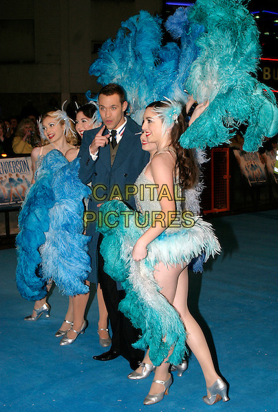 "WILL YOUNG.""Mrs. Henderson Presents"" - UK film premiere at Vue West End, London, UK..November 23rd, 2005.Ref: AH.full length feathers costume dress up pointing.www.capitalpictures.com.sales@capitalpictures.com.© Capital Pictures."