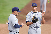 July 8, 2009: Tri-City Dust Devils pitcher Craig Bennigson chats with pitching coach Darryl Scott prior to a Northwest League game against the Salem-Keizer Volcanoes at Volcanoes Stadium in Salem, Oregon.