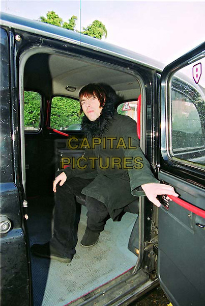 LIAM GALLAGHER .The Mild Man Of Rock Leaving His London Home Which he Shares With Nicole Appleton & Baby Son Gene To Go To A Gig Tonight In Watford, Liam Was In Very Good Spirits Anb Stopped To TalkTo Celebrity Snapper, Zed, Before Being Driven Off In A London Taxi.Ref: ZED.full length, full-length, paparazzi picture.www.capitalpictures.com.sales@capitalpictures.com.©Capital Pictures