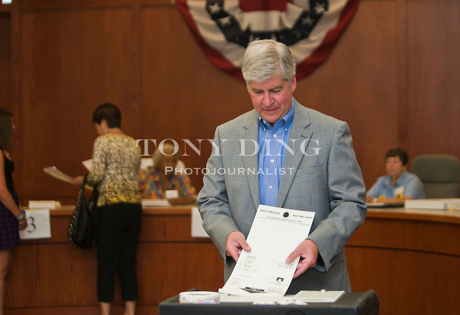 Michigan Republican gubernatorial candidate Rick Snyder casts his vote in the primary election, Tuesday, Aug. 3, 2010, in Superior Township, Mich. (AP Photo/Tony Ding)