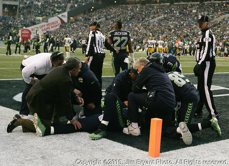 Seattle Seahawks medical staff and head coach Pete Carroll huddle with wide receiver Jimmy Graham (88) after he was injured on a play at CenturyLink Field in Seattle, Washington on November 29, 2015.  Graham received a season ending injury in the Seahawks 39-30 win over the Steelers.      ©2015. Jim Bryant Photo. All Rights Reserved.