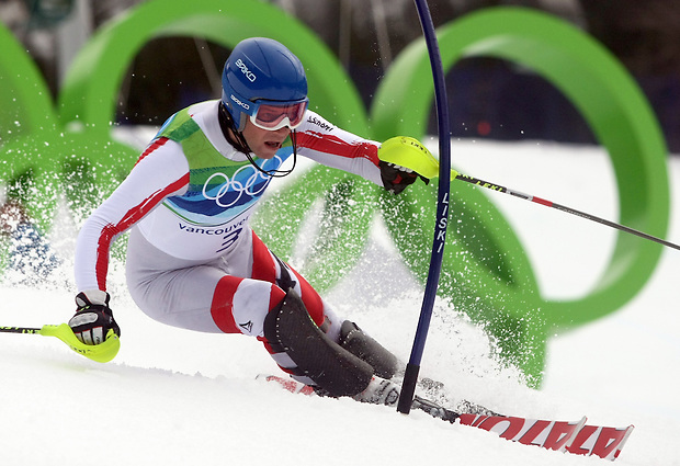 Austria's Benjamin Raich speeds past a gate in the men's slalom at the XXI Olympic Winter Games Saturday, February 27, 2010 in Whistler, British Columbia.