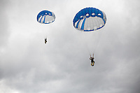 "Forest Service smokejumpers throughout the United States have jumped with circular parachute canopies since 1939, although square canopies were developed in the 1960s and '70s and are currently used by smokejumpers who work for the Bureau of Land Management. Square-shaped canopies behave more like a wing, requiring forward speed in order to stay aloft. Circular canopies rely primarily on drag, making it easier for a jumper to drop straight down. There are pros and cons to both designs: While circular canopies can descend at a nearly vertical trajectory, they become difficult to control when the wind blows faster than 10 mph. The BLM's square models, sometimes called ""ram-air"" chutes because they behave like airfoils, remain maneuverable at twice that speed."