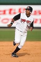 Third baseman Juan Francisco #34 of the Carolina Mudcats hustles towards third base versus the Jacksonville Suns at Five County Stadium May 18, 2009 in Zebulon, North Carolina. (Photo by Brian Westerholt / Four Seam Images)