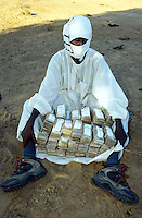Sudan. South Sudan. Bahr El Ghazal. Mayen Abun. Christian Solidarity International (CSI) buys back dinka slaves from muslim arab traders. A trader shows the money from the last sale. © 1999 Didier Ruef