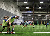 """NWA Democrat-Gazette/CHARLIE KAIJO Reagan Crusinbery, 10, of Centerton and Davis Infante, 13, of Centerton (from left) play one-versus-one during a three-day New Year's Soccer Camp, January 4, 2019 at Strike Zone Training Academy in Rogers. <br /><br />The Specialized Soccer Academy hosted a three-day soccer camp to help build confidence in young athletes.<br /><br />""""If they build confidence in a sport they feel like they have something that's theirs,"""" said Coach Sarita Saavedra. """"They help themselves get better and that translates to confidence in the classroom or anything.""""<br /><br />The kids worked on juggling skills, one-versus-one practice and scrimmages."""