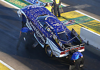 Aug 15, 2014; Brainerd, MN, USA; Crew members do some final adjustments before NHRA funny car driver Tommy Johnson Jr makes a run during qualifying for the Lucas Oil Nationals at Brainerd International Raceway. Mandatory Credit: Mark J. Rebilas-