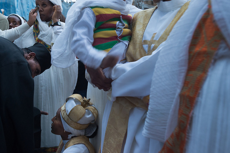 Orthodox-Ethiopian Christian pilgrims and clerics at Deir Al-Sultan, the Ethiopian section of the Church of Holy Sepulchre in Jerusalem's old city, during the Holy Fire ceremony as part of Easter. The ancient fire ritual celebrates the Messiah's resurrection after being crucified on the cross.