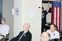 People gather to hear local political candidates and learn about the phonebanking system at the Palm Beach Republican Club and West Palm Beach Victory Headquarters office in West Palm Beach, Florida. The office serves as a place for volunteers to gather and organize for various Republican campaigns, including Donald Trump's general election campaign.