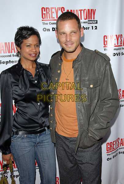 KEISHA CHAMBERS & JUSTIN CHAMBERS.The Grey's Anatomy 2nd Season DVD Launch held at Social in Hollywood, California, USA..September 5th, 2006.Ref: DVS.half length grey gray leather jacket cross orange hands in pockets black wife husband married.www.capitalpictures.com.sales@capitalpictures.com.©Debbie VanStory/Capital Pictures