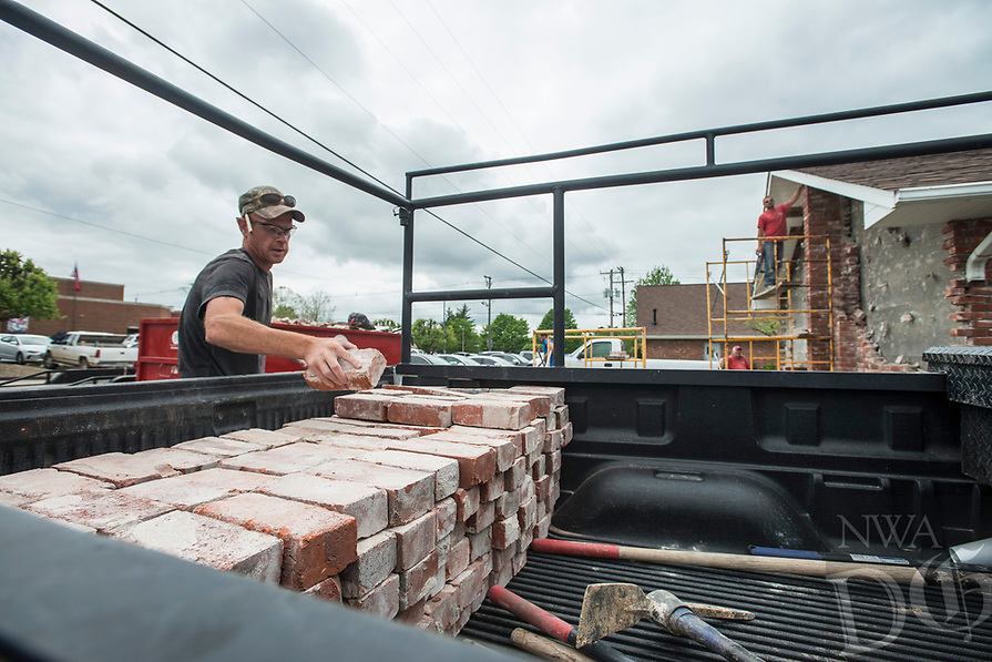 NWA Democrat-Gazette/ANTHONY REYES @NWATONYR<br /> Chad Robinson, with Josh Hurtt Construction, salvages bricks from a demolition job Monday, April 17, 2017 at the Downtown Church of Christ in Rogers. The church will expand and the company will demolish the wall, pour the added foundation and rebuild the new brick walls when completed.