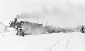 D&amp;RGW #488 and #485 with westbound San Juan making Chama station stop.  Heavy, recent snow.<br /> D&amp;RGW  Chama, NM  Taken by Richardson, Robert W. - 1/30/1951