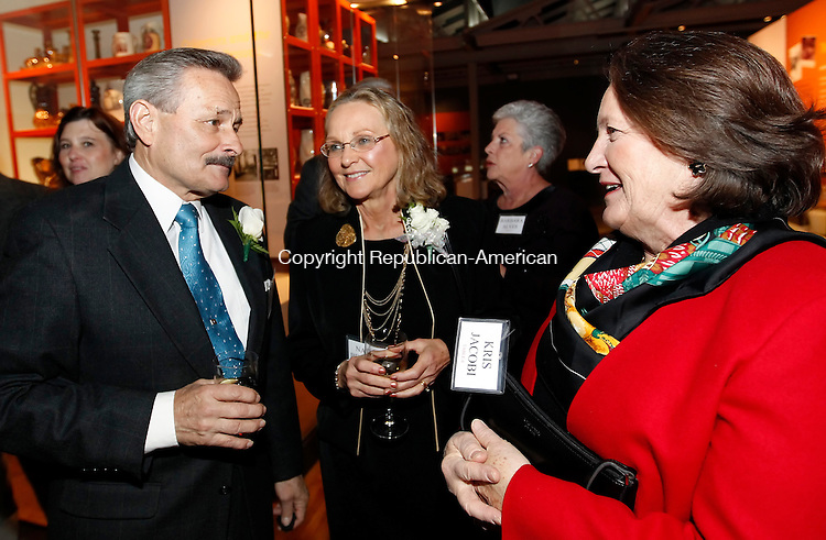 Waterbury, CT-20 December 2011-121911CM05-  James P. Behuniak (left) president of Platt Brothers & Company enjoys a conversation with his wife, Nancy (center) and Kris Jacobi, of Middlebury and a member of the board of directors of Platt Bros. during a retirement party for Behuniak and Milton D. Grele, President of the Board of Directors at the Mattatuck Museum in Waterbury Monday night.  Christopher Massa Republican-American