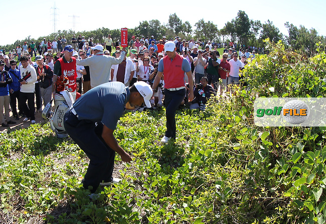 Tiger Woods (USA) calls over Martin Kaymer (GER) to looking at where his tee shot was in the bushes on the 5th during the second round at the Abu Dhabi HSBC Golf Championship in the Abu Dhabi golf club, Abu Dhabi, UAE..Picture: Fran Caffrey/www.golffile.ie.