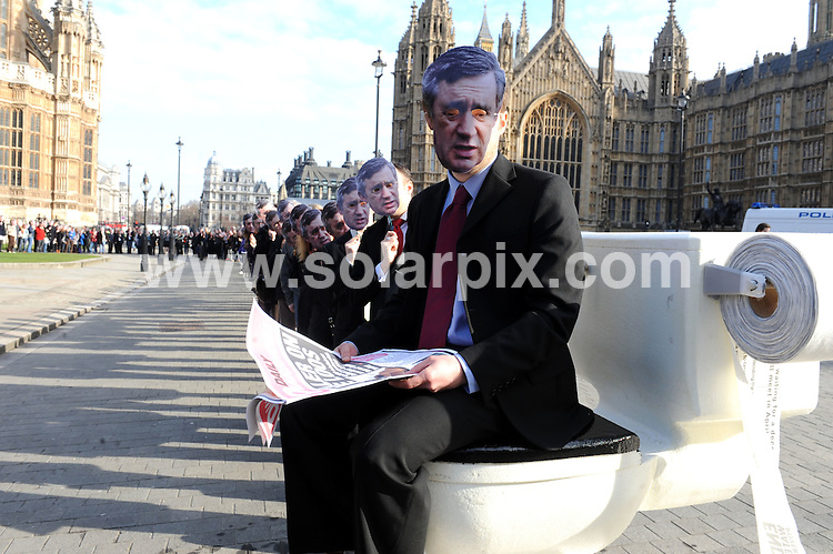 **ALL ROUND PICTURES FROM SOLARPIX.COM**.**NO UK NEWSPAPER PUBLICATION**.**UK MAGAZINE & SUPPLEMENT PUBLICATION ONLY** AND NO PUBLICATION IN AUSTRALIA, BELGIUM, FRANCE, GERMANY, ITALY, SCANDINAVIA AND USA** .Over a hundred people wearing Gordon Brown masks queued in front of a giant toilet in Old Palace Yard, Westminster, London for UN World Water Day, to support the campaign group End Water Poverty', and their call for the Prime Minister to tackle the global sanitation. London, UK. 22 March 2010..This pic: Gordon Brown masks..JOB REF: 10955 SFE       DATE: 22_03_2010.**MUST CREDIT SOLARPIX.COM OR DOUBLE FEE WILL BE CHARGED**.**MUST NOTIFY SOLARPIX OF ONLINE USAGE**.**CALL US ON: +34 952 811 768 or LOW RATE FROM UK 0844 617 7637**