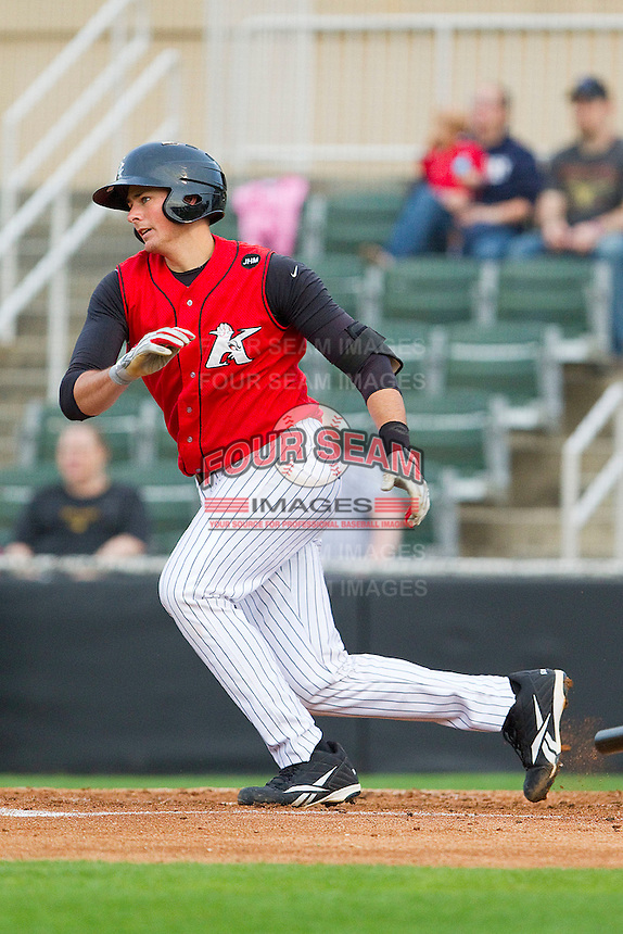 Mike Blanke #32 of the Kannapolis Intimidators follows through on his swing against the West Virginia Power at Fieldcrest Cannon Stadium on April 21, 2011 in Kannapolis, North Carolina.   Photo by Brian Westerholt / Four Seam Images