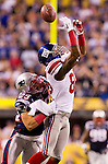 New England Patriots defensive back Sterling Moore (29) breaks up a pass intended for New York Giants wide receiver Mario Manningham (82) during the NFL Super Bowl XLVI football game on Sunday, Feb. 5, 2012, in Indianapolis. The Giants won 21-17 (AP Photo/David Stluka)...