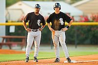 Bristol White Sox hitting coach Greg Briley #15 (left) chats with Collin Kuhn #36 at third base during the game against the Burlington Royals at Burlington Athletic Park on July 10, 2011 in Burlington, North Carolina.  The White Sox defeated the Royals 4-3.   (Brian Westerholt / Four Seam Images)
