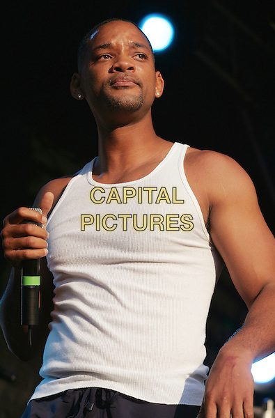 "WILL SMITH.Premiere of ""I, Robot"", Pathe Arena Cinema,  Amsterdam, Holland..July 28th, 2004.Ref: SH.half length stage concert live gig performance white tank top .www.capitalpictures.com.sales@capitalpictures.com.©Capital Pictures"
