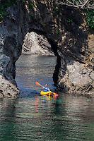 Kayaker, sea cave, Futo Beach, Izu Peninsula, Japan