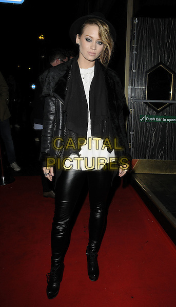KIMBERLEY WYATT .Attending the Michael Jackson Experience game launch at Whisky Mist, London, England, UK, .November 18th 2010..full length black leather jacket white top kimberly trousers wedges  ankle boots .CAP/CAN.©Can Nguyen/Capital Pictures.
