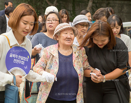 Kil Won-ok and Kim Bok-dong, Aug 29, 2016 : Kil Won-ok (C, front) and Kim Bok-dong (2nd R, second row), who said that they were forced to become a sex slave by Japanese army during World War II, attend an opening ceremony for a park commemorating the victims of Japan's sexual enslavement during Japan's occupation of the Korean Peninsula (1910-45), on Mount Nam in Seoul, South Korea. The Seoul Metropolitan Government and a committee which is charge of building the memorial park held the ceremony on Monday, which  marks the 106th anniversary of the colonization. The place of the memorial park is the former residence of Japan's colonial-era resident-general, where the annexation treaty between Korea and Japan was signed on August 22, 1910. The treaty went into effect one week later. (Photo by Lee Jae-Won/AFLO) (SOUTH KOREA)