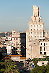Havana, Cuba; the Dragon Gate across Calle Dragones, announces the entrance to China Town, viewed from the top of the Saratogo Hotel in early morning sunlight