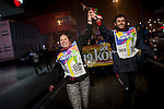 "A couple carries a baton on the ""19th Korrika"" before dawn, on a rainy morning. Irun (Basque Country) March 22, 2015. The ""Korrika"" is a relay course, with a wooden baton that passes from hand to hand without interruption, organised every two years in a bid to promote the basque language. The 19th Korrika will run over 11 days and 10 nights, crossing many Basque villages and cities, totalling some 2300 kilometres. Some people consider it an honour to carry the baton with the symbol of the Basques, ""buying"" kilometres to support Basque language teaching. The ""Korrika"" this year ends in Bilbao on March 29. (Gari Garaialde / Bostok Photo)"