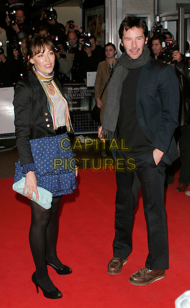 "GUEST & KEANU REEVES .at the premiere of ""Anvil! The Story Of Anvil"" during the Times BFI 52nd London Film Festival, at the Odeon West End, London, England, .October 21, 2008..full length grey gray scarf black navy suit blue dress Print skirt jacket clutch bag tights brown shoes .CAP/AH.©Adam Houghton/Capital Pictures"