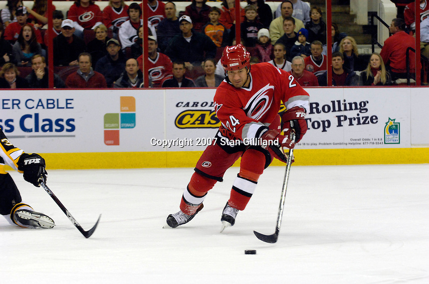 Carolina Hurricanes' Scott Walker (24) brings a puck up ice against the Boston Bruins Saturday, Feb. 3, 2007 at the RBC Center in Raleigh. Boston won 4-3 in overtime.