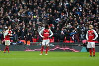 Arsenal playuers wait to restart the game after Kanes goal during Tottenham Hotspur vs Arsenal, Premier League Football at Wembley Stadium on 10th February 2018