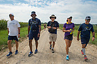 August 14, 2017; On Day 1 of the ND Trail, pilgrims make the 19 mile trek from Vincennes to the Morris Chapel in Oaktown, Indiana. As part of the University's 175th anniversary celebration, the Notre Dame Trail will commemorate Father Sorin and the Holy Cross Brothers' journey. A small group of pilgrims will make the entire 300+ mile journey from Vincennes to Notre Dame over  two weeks. (Photo by Barbara Johnston/University of Notre Dame)