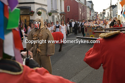 Hunting the Earl of Rone. Combe Martin Devon Exmoor Uk. The Earl being shot by Grenadier guards. Death and revival. Hobby Horse in backgropund will come and revive the Earl.