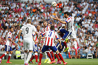 Gareth Bale and Benzema of Real Madrid and Raul Garcia of Atletico de Madrid during La Liga match between Real Madrid and Atletico de Madrid at Santiago Bernabeu stadium in Madrid, Spain. September 13, 2014. (ALTERPHOTOS/Caro Marin)