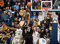 California defenders Gennifer Brandon and Reshanda Gray try to block Stanford's Amber Orrange's shot during the game at Haas Pavilion in Berkeley, California on January 8th, 2013.  Stanford defeated California, 62-53.