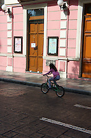 Girl riding a bicycle during Sunday bici ruta on Calle 60 in Merida, Yucatan, Mexico...