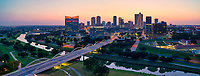 Early morning pano in downtown Fort Worth as the sky was lighting up the cityscape with soft pink behind the city at dawn. You can see the reflections in the Trinity River below of the trees along the bank and the seventh street bridge that connects the university area to downtown. Fort Worth is the fifth largest city in Texas and the second largest in the DFW Metro area. Fort has been known as a cow town for many years but it really is a modern city with some first class museums and urban areas like the water gardens and the botanical gardens in the city.