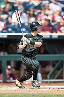 Vanderbilt Commodores shortstop Ethan Paul (10) follows through on his swing during Game 8 of the NCAA College World Series against the Mississippi State Bulldogs on June 19, 2019 at TD Ameritrade Park in Omaha, Nebraska. Vanderbilt defeated Mississippi State 6-3. (Andrew Woolley/Four Seam Images)